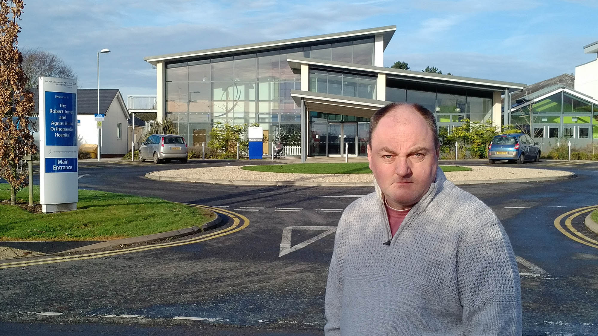 David walker outside RJ&AH Hospital under threat of cuts to services including the Maternity Unit