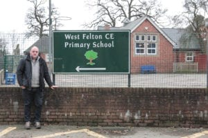 David Walker outside West Felton School