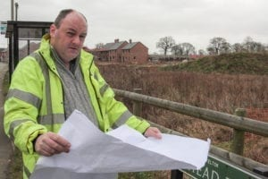David Walker, a Civil Engineering Surveyor, at one of the many unplanned housing sites.