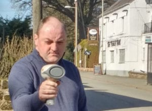 David Walker using a speed gun in West Felton