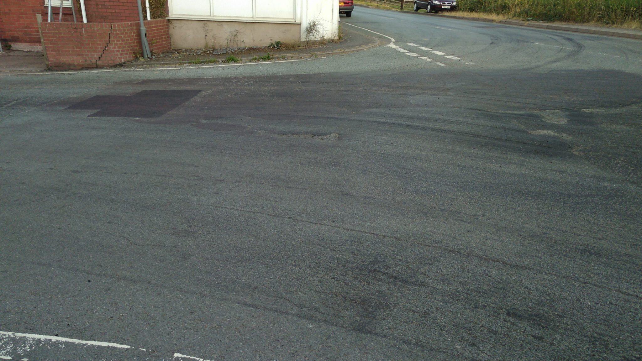 A better patch repair has been done but still leaves the junction in need of a full repair