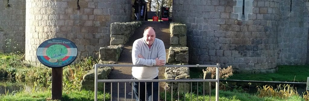 Cllr David Walker standing outside Whittington Castle